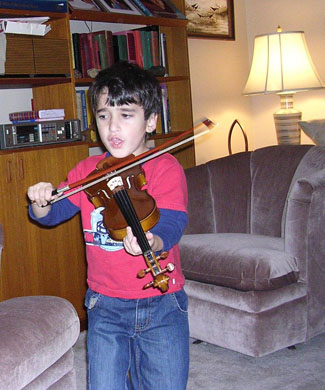 Little Boy First Time Playing Violin