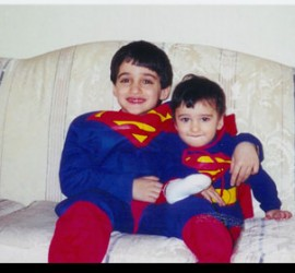 Two brothers dressed in super hero costumes