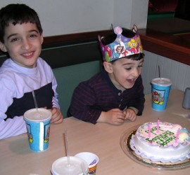 Little boy excited with his birthday cake