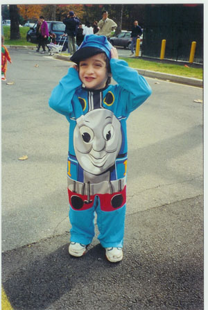 young child in train outfit