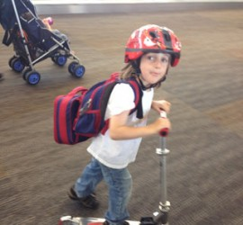 Child on Scooter in Airport