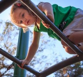 Little Girl Climbing on Playground_edited-1