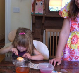 Young girl coloring her Easter egg