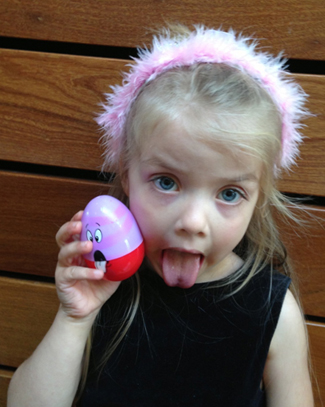Young Girl Posing with Her Easter Egg
