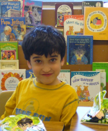 young child at reading nook