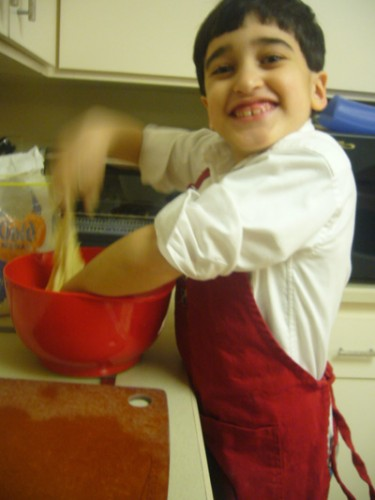 Young Boy Making Bread
