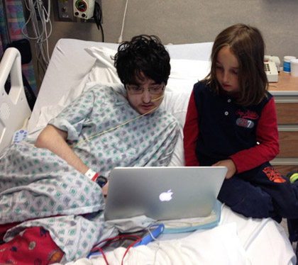 Hospitalized sick boy and younger healthy boy
