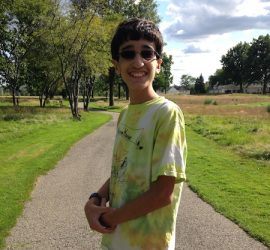 Boy outside with scenery at diagnosis with serious disease